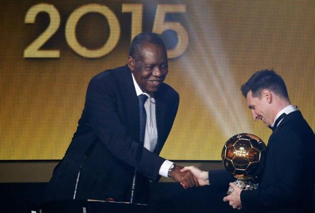 FIFA acting president Issa Hayatou (L) congratulates FC Barcelona's Lionel Messi of Argentina with winning the FIFA Ballon d'Or 2015 award for the world player of the year at a ceremony in Zurich, Switzerland, January 11, 2016. REUTERS/Ruben Sprich