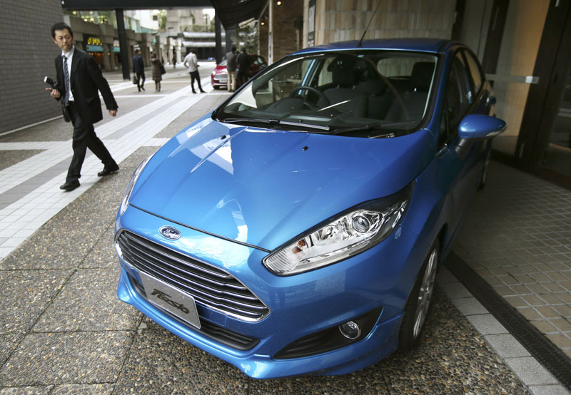 FILE - A man looks at a Ford Fiesta compact car in Tokyo on Thursday, January 9, 2014. Photo: AP