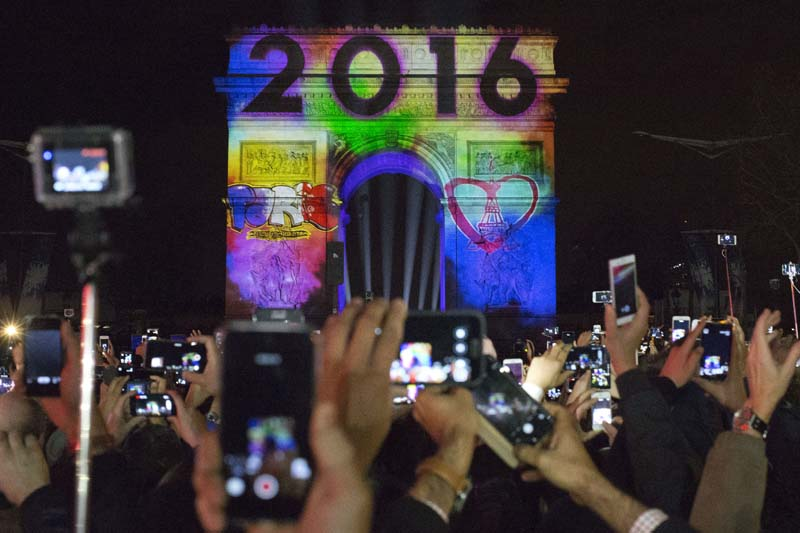 The 2016 appears during the 5-minute video performance displayed on the Arc de Triomphe as part of New Year's Eve celebrations on the Champs Elysees Avenue in Paris, France, Friday, January 1, 2016. Photo: AP
