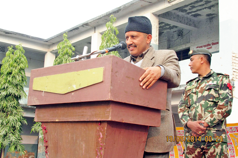 Minister for Education Giriraj Mani Pokhrel speaking at a programme in Itahari of Sunsari district on Sunday, January 17, 2016. Photo: RSS