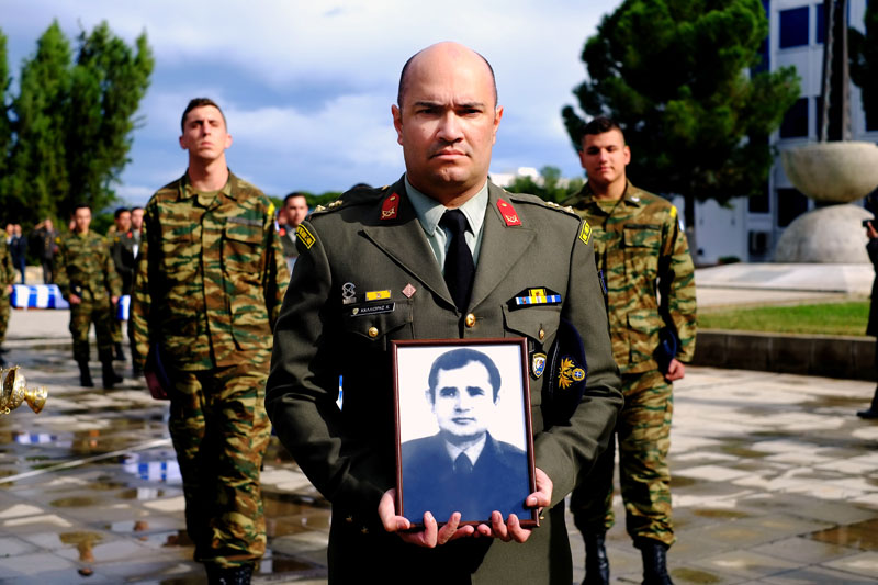 Greek soldiers carrying the coffins and the photographs of the Greek soldiers killed in fighting during ethnically divided Cyprusu2019 tumultuous past in the courtyard of the islandu2019s National Guard headquarters on Monday, January 18, 2016. Photo: AP