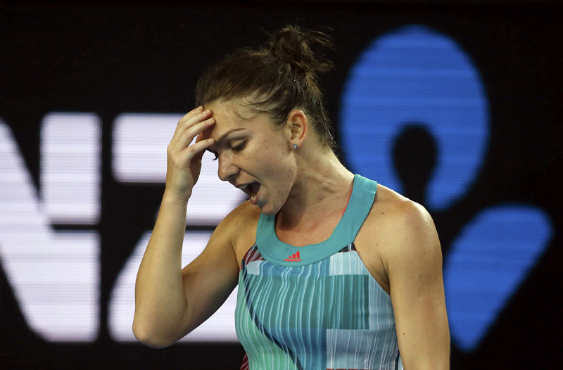 Romania's Simona Halep reacts after losing a point during her first round match against China's Zhang Shuai at the Australian Open tennis tournament at Melbourne Park, Australia, January 19, 2016. Photo: Reuters