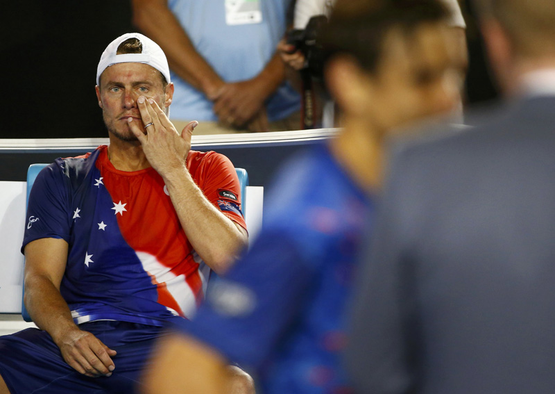 Australia's Lleyton Hewitt sits in his chair as Spain's David Ferrer is interviewed after Ferrer won their second round match at the Australian Open tennis tournament at Melbourne Park, Australia, January 21, 2016. Photo: Reuters