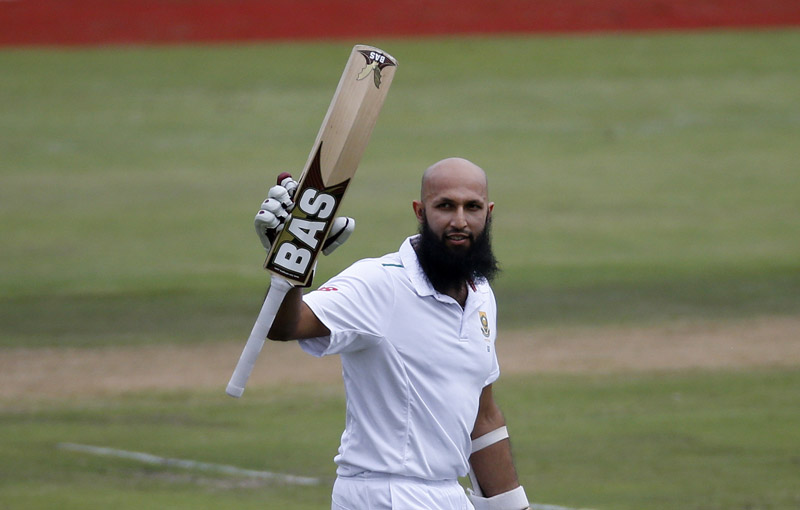 South Africa's Hashim Amla celebrates after scoring a century against England during the fourth Test match at Centurion on Friday. Photo: Reuters