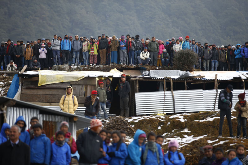 Earthquake-affected people gather to receive winter relief materials in Helumbu, a village located in Sindhupalchok district on Thursday, January 21, 2016. Photo: Skanda Gautam