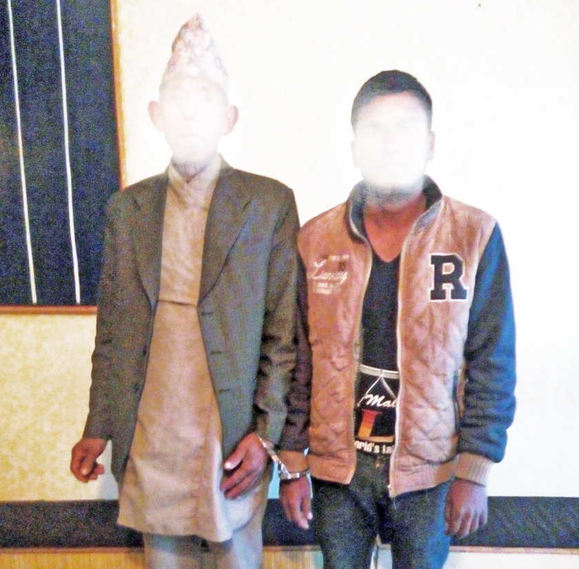 Hemraj Adhikari (right) accused of raping a girl, along with his helper Nar Bahadur Yonghang arrested by Panchthar District Police Police Office on Sunday, January 17, 2016. Photo: Laxmi Gautam