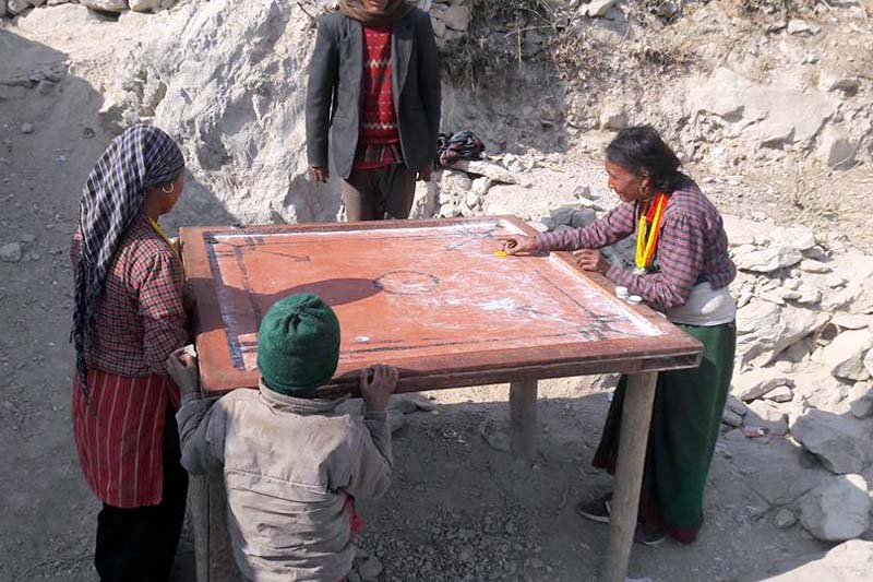 Local elderly women playing carromboard in Maila VDC of Humla on Thursday, January 7, 2016. Photo: Prakash Singh/ THT
