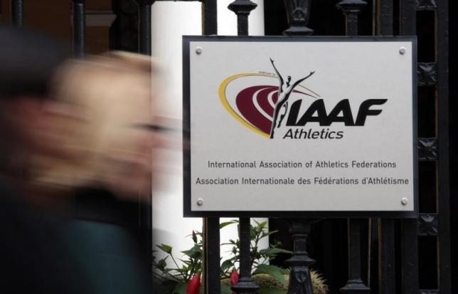 A woman walks past the IAAF (The International Association of Athletics Federations) headquarters in Monaco November 4, 2015. Photo: Reuters