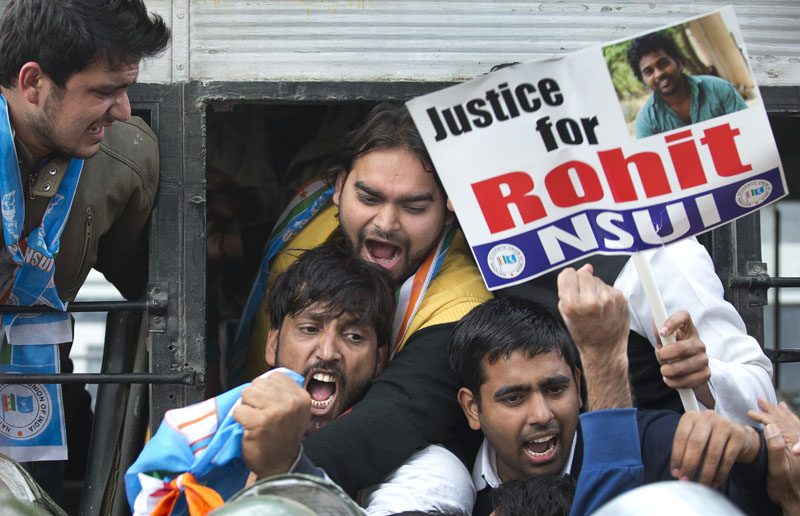 Indian students shout slogans as they are detained while protesting the death of an Indian student who, along with 4 others, was barred from using some facilities at his university in the southern tech-hub of Hyderabad, in New Delhi, India, on Tuesday, January 19, 2016. Photo: AP