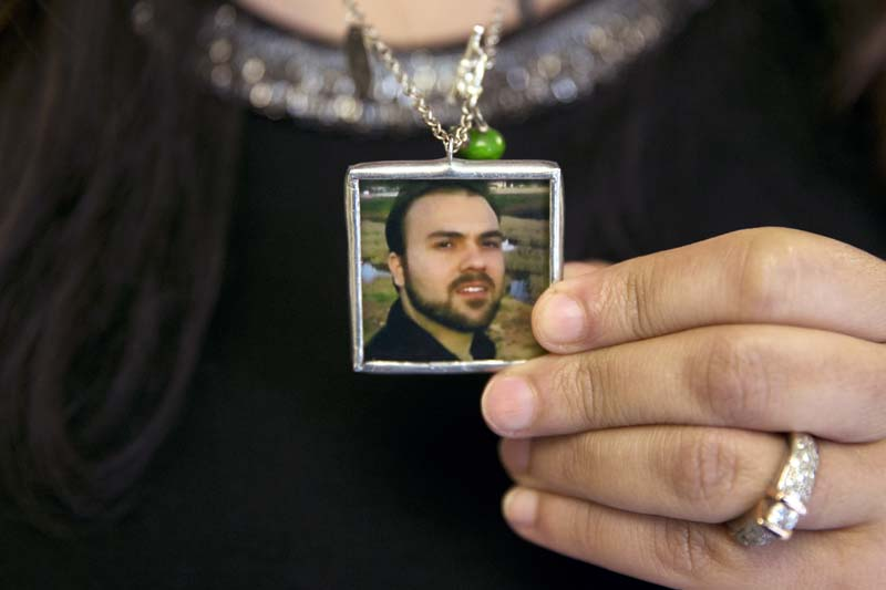 Naghmeh Abedini holds a necklace with a photograph of her husband, Saeed Abedini, on Capitol Hill in Washington on June 2, 2015. Photo: AP/ File