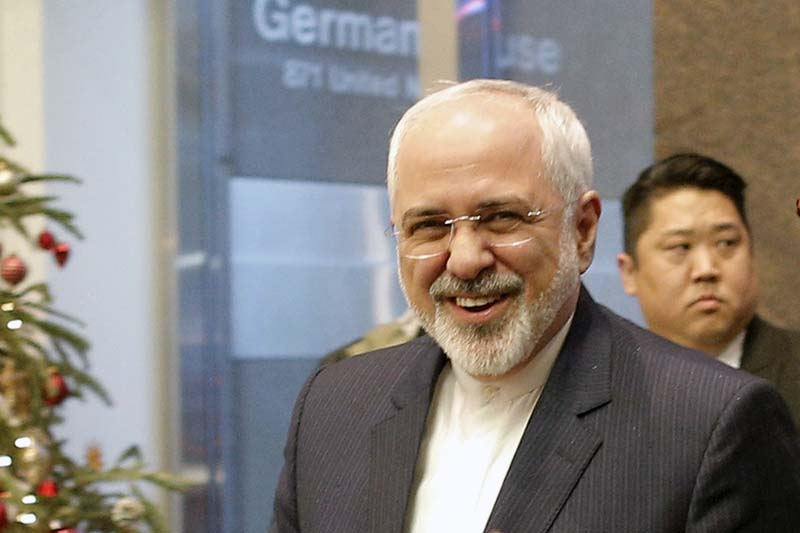 Iranian Foreign Minister Mohammad Javad Zarif is greeted as he arrives at the German Mission to the United Nations in New York, December 17, 2015. Photo: Reuters