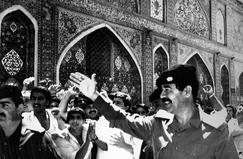 FILE - Iraqi President Saddam Hussein waves to cheering crowds during a visit to the holy muslim shrines in Samara on August 9, 1988. The Iraqi President visited the site for prayers and thanks following the agreement on a ceasefire in the 8-year-old Iran-Iraq war. After the overthrow of the shah and takeover of the US Embassy in Tehran, Saudi Arabia quickly became America's top ally in the region. In the ensuing 1980s war between Iran and Iraq, Saudi Arabia backed Iraq despite its concerns about dictator Saddam Hussein. Photo: AP