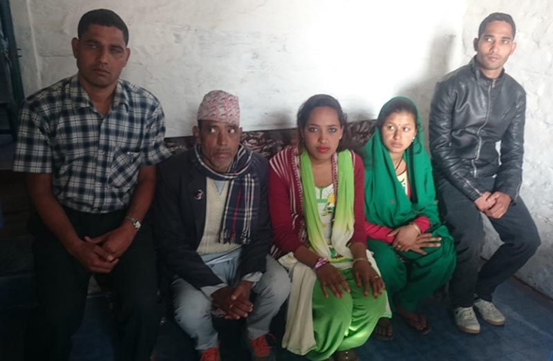 Inter-caste couple Ganesh Chadara Sunar and Jyoti Shah (1st and second from right) with their family members at the Jajarkot District Police Office, on Thursday, January 28, 2016. Photo: Dinesh Kumar Shrestha