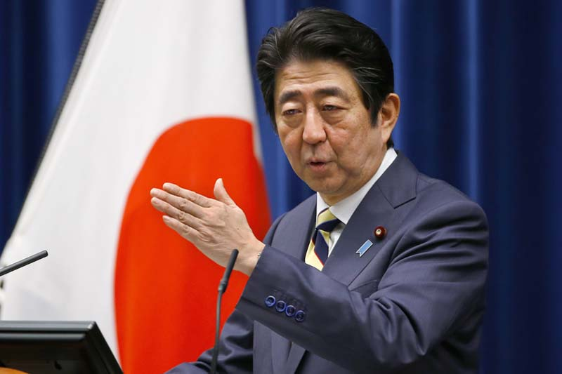 Japanese Prime Minister Shinzo Abe speaks to the media during the New Year's press conference at his official residence in Tokyo, Monday, January 4, 2016. Photo: AP