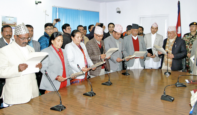 Prime Minister KP Sharma Oli adminsters the oath of office and secrecy to newly appointed six ministers of state in Singha Durbar on Friday, January 1, 2016. Photo: RSS