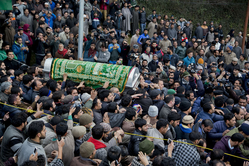 People carry a coffin containing the body of Jammu and Kashmir Chief Minister Mufti Mohammed Sayeed during his funeral procession in Srinagar, Indian controlled Kashmir, on Thursday, January 7, 2016. Photo: AP