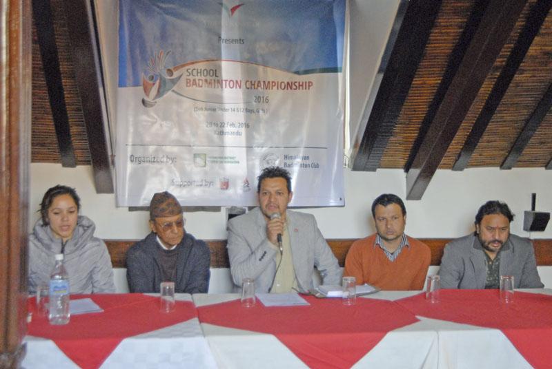 Kathmandu District Badminton Association President Deepak Thapa (centre) gestures during a press meet in Kathmandu on Thursday. Photo: THT