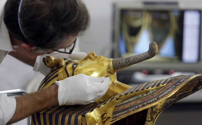 FILE - In this Tuesday, Oct. 20, 2015 file photo, German restorer Christian Eckmann begins restoration work on the golden mask of King Tutankhamun over a year after the beard was accidentally broken off and hastily glued back with epoxy, at the Egyptian Museum in Cairo. Photo: AP