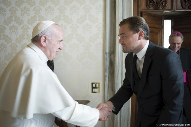 Pope Francis shakes hands with actor Leonardo DiCaprio (2nd R) at the Vatican, January 28, 2016. REUTERS/Osservatore Romano/Handout via Reuters