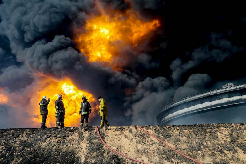 Firefighters try to put out the fire in an oil tank in the Libyan oil terminal of Es Sider, in Ras Lanuf, Libya, on January 6, 2016. Photo: Reuters