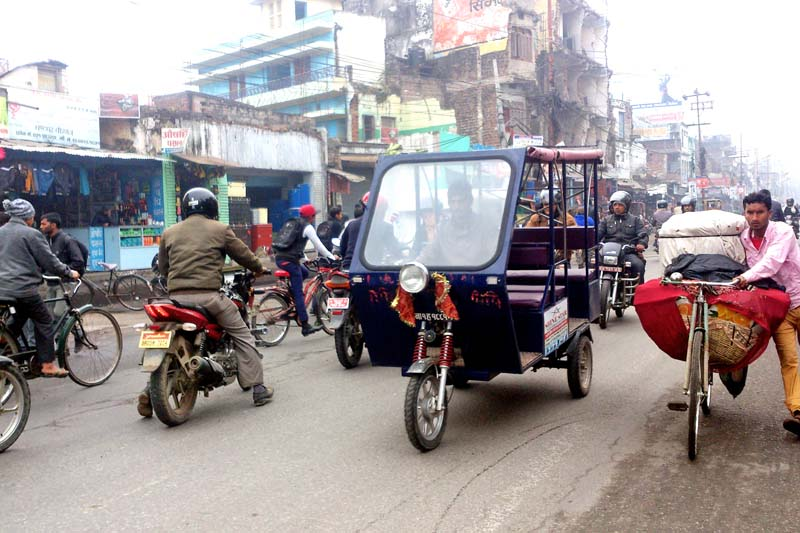 Locals commuting toward their destinations after the protest of the United Democratic Madhesi Front (UDMF) cooled down their protest following a rainfall, in Ghantaghar of Birgunj on Thursday, January 21, 2016. Photo: Ram Sarraf/ THT