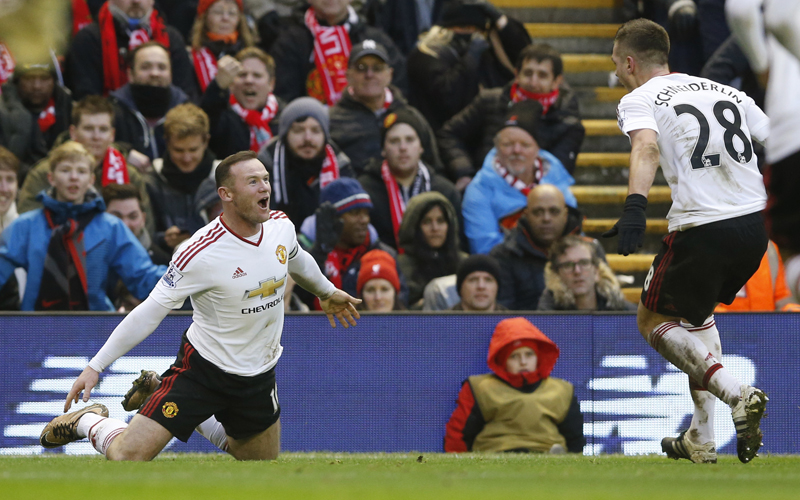 Manchester United's Wayne Rooney celebrates scoring their first goal with Morgan Schneiderlin during Barclays Premier League against Liverpool at Anfield on Sunday, January 17, 2016. Photo: Reuters
