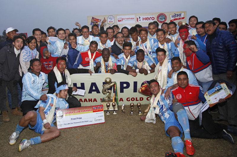 Manang Marshyangdi Club players and officials celebrate with fans after winning the 14th Aaha-Rara Gold Cup at the Pokhara Stadium on Saturday. Photo: Sudarsan Ranjit