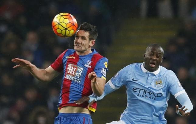 Football Soccer - Manchester City v Crystal Palace - Barclays Premier League - Etihad Stadium - 16/1/16nManchester City's Yaya Toure in action with Crystal Palace's Scott DannnReuters / Phil NoblenLivepic