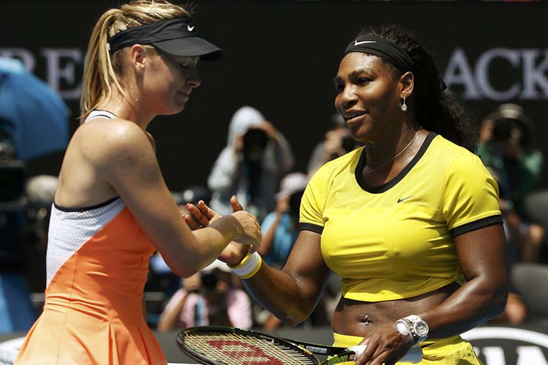 Russia's Maria Sharapova (left) reacts as she shakes hands with Serena Williams of US after Williams won their quarter-final match at the Australian Open tennis tournament at Melbourne Park, Australia, on January 26, 2016. Photo: Reuters