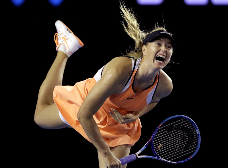 Maria Sharapova of Russia serves to Lauren Davis of the United States during their third round match of the Australian Open in Melbourne on Friday. Sharapova won 6-1, 6-7 (5/7), 6-0. Photo: AP