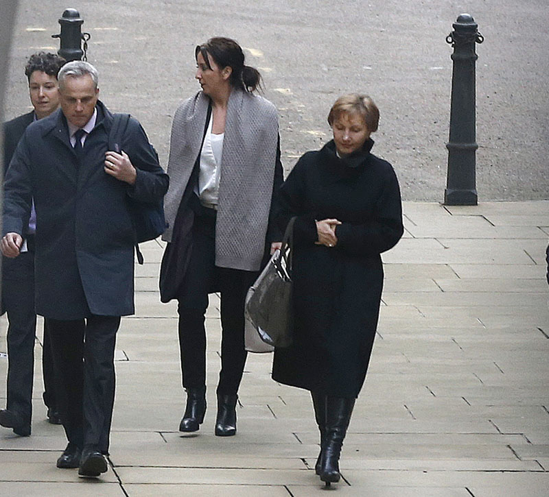 Marina Litvinenko (right) in black coat, widow of former Russian spy Alexander Litvinenko, arrives at The Royal Courts of Justice for the Litvinenko Inquiry statement following publication of the report in London, on Thursday, January 21, 2016. Photo: AP
