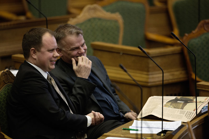 Martin Henriksen (left) and Christian Langballe from The Danish People's Party, sit in Parliament, in Copenhagen on Tuesday January 26, 2016. Photo: Peter Hove Olesen/ POLFOTO via AP