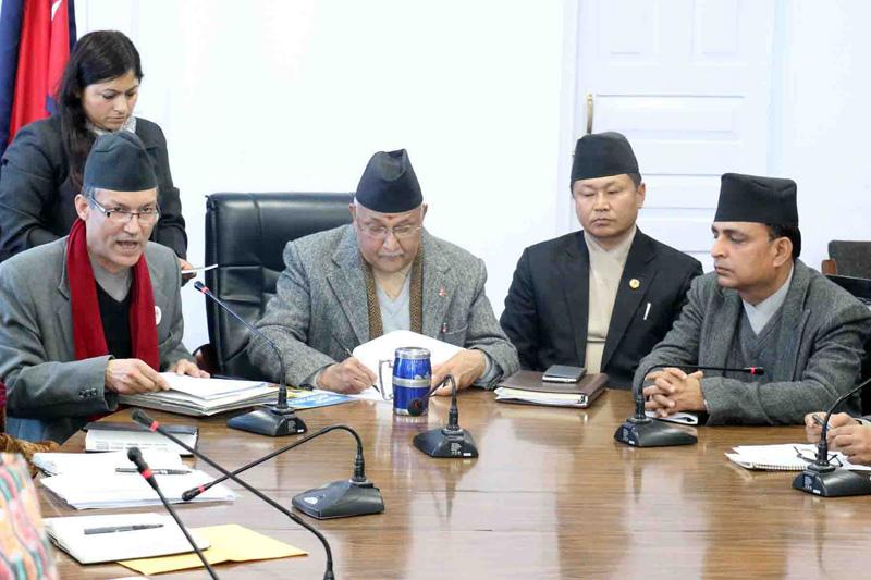 Chairman of the National Information Commission Krishna Hari Banskota (l) presents a report to Prime Minister KP Sharma Oli, in Kathmandu, on Monday, January 18, 2016. Photo: RSS