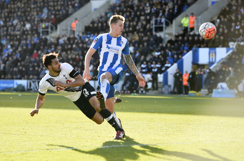 Tottenham Hotspurs' Nacer Chadli (left) shoots the ball to score teamu0092s third goal against nColchester United during their  FA Cup match in Colchester on Saturday. Photo: Reuters
