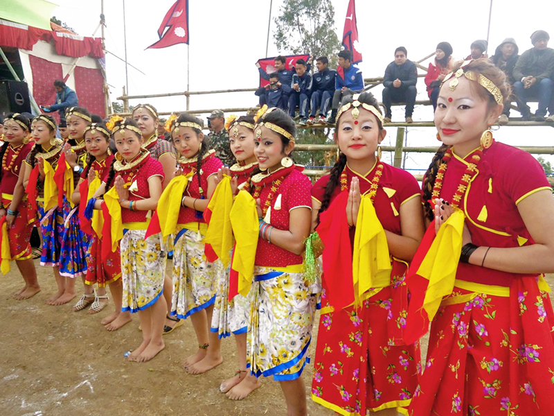 Girls dressed in traditional costumes wait to welcome players at the inauguration function of the International Invitition Maipokhari Gold Cup in Tundikhel of Ilam district on Friday, January 29, 2016. Photo: RSS
