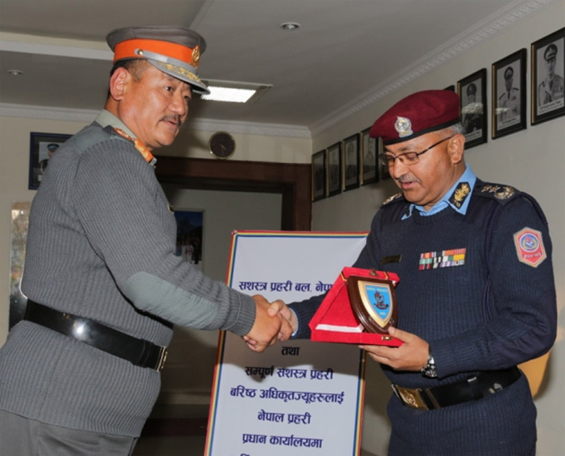 Nepal Police Inspector General Upendra Kant Aryal (left) offers a token of love to Armed Police Force Acting IG Durja Kumar Rai as the latter visits the Nepal Police headquarters, in Naxal of Kathmandu, on Thursday, January 7, 2016. Aryal had visited the APF headquarters in Halchok to congratulate Rai a few days ago. Photo: Nepal Police