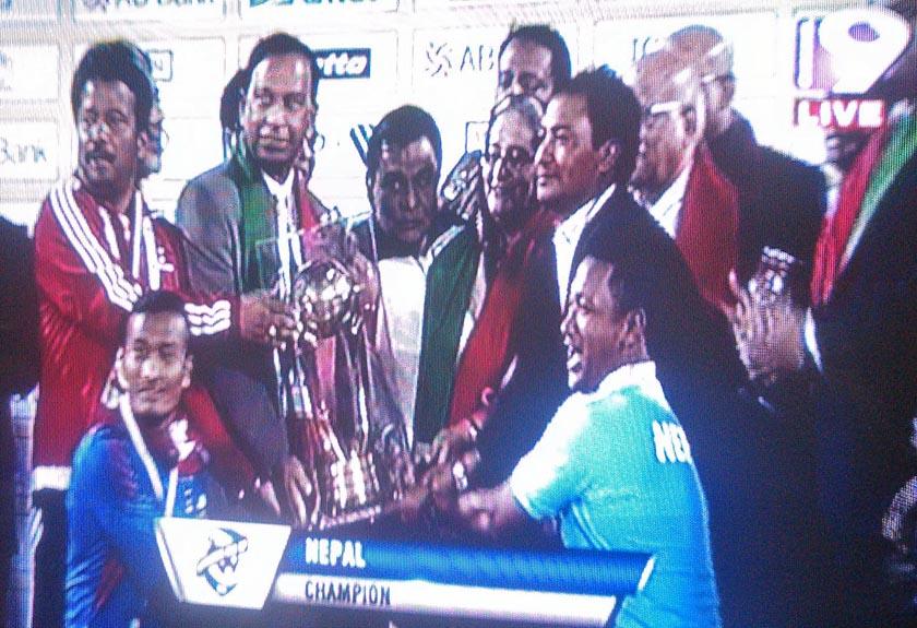 This TV grab shows Nepal national football team lifting the Bangabandhu Gold Cup in Dhaka, on Friday, January 22, 2016.