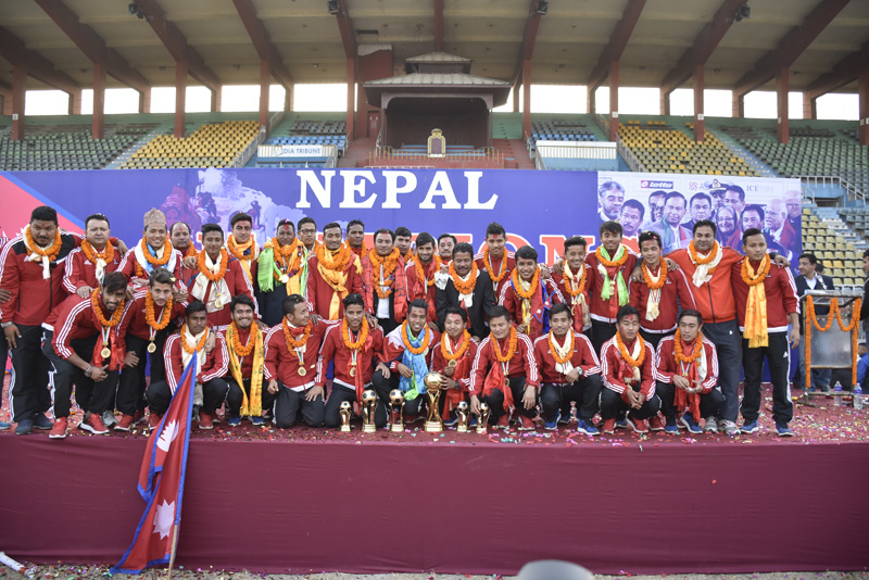 Nepal national football team members and officials pose during a felicitation programme at the Dasharath Stadium. Photo: NARESH SHRESTHA/THT