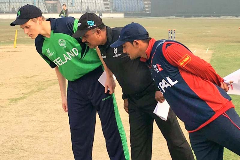 (From left) Ireland U-19 cricket captain, Jack Tector, match referee and Nepal captain, Raju Rijal, during the toss in U-19 ICC Cricket World Cup at the Khan Shaheb Osman Ali Stadium, Fatullah in Bangladesh on Saturday, January 30, 2016. Courtesy: twitter.com/@NepalCricket