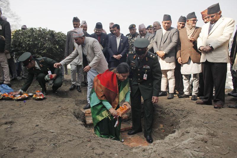 Nepal's President Bidya Devi Bhandari (centre) in green, lays a foundation stone for earthquake reconstruction in Kathmandu, Nepal, on Saturday, January 16, 2016. Photo: AP