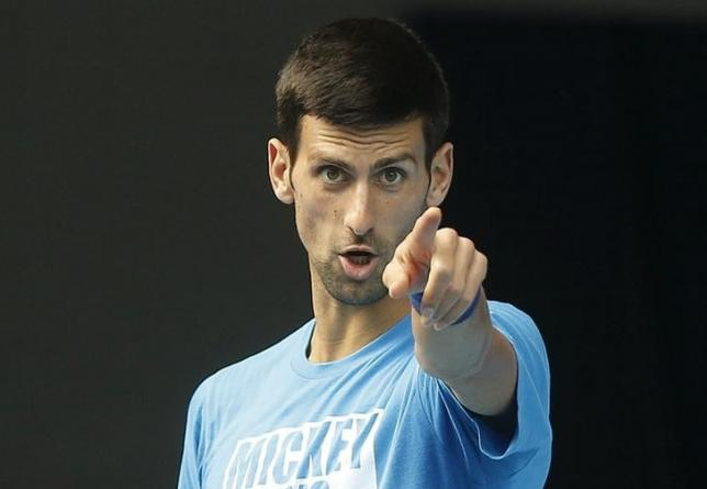 Serbia's Novak Djokovic gestures during a practice session on the eve of his final match against Britain's Andy Murray, at the Australian Open tennis tournament at Melbourne Park, Australia, January 30, 2016. REUTERS/Brandon Malone