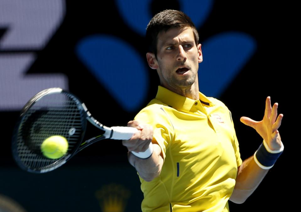 Novak Djokovic of Serbia makes a forehand return to Chung Hyeon of South Korea during their first round match at the Australian Open tennis championships in Melbourne, Australia, Monday, Jan. 18, 2016. Photo: AP/Vincent Thian