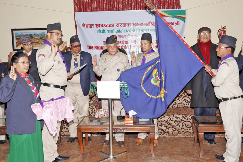 Chief Commissioner Rabindra Dahal of the Nepal Scout inducing Prime Minister KP Sharma Oli as Patron of the Nepal Scouts an investiture ceremony organised at its headquarters in Lainchaur, Kathmandu, on Tuesday, January 05, 2016. Photo: RSS
