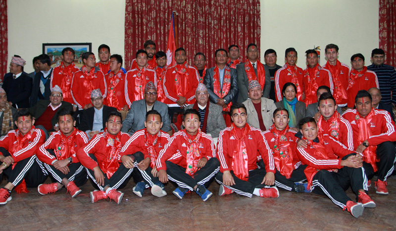 Prime Minister KP Sharma Oli poses for a photograph with the Nepal national football team  members in Baluwatar of Kathmandu, on Thursday, January 28, 2016. Photo: RSS