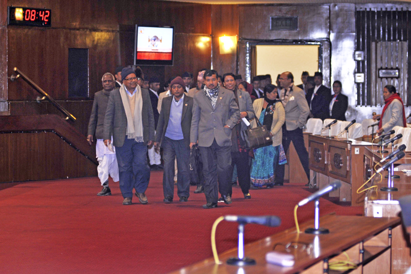 Madhesi lawmakers walking out of the Parliament after Sadbhawana Party's Laxman Lal Karna's speech in which he accused the Big III of holding the country hostage by not addressing the concerns of Madhesi people, on Tuesday, January 19, 2016. Photo: THT