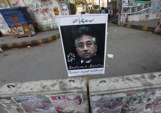 A placard of former President Pervez Musharraf is left behind by his supporter after a protest demanding a fair trial for him in Karachi March 9, 2014. REUTERS/Akhtar Soomro/Files
