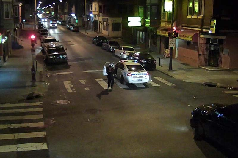 A still image from surveillance video shows Philadelphia Police Officer Jesse Hartnett chasing a gunman (not shown) after being shot in this Philadelphia Police Department image released on January 8, 2016. Photo: Philadelphia Police Department via Reuters