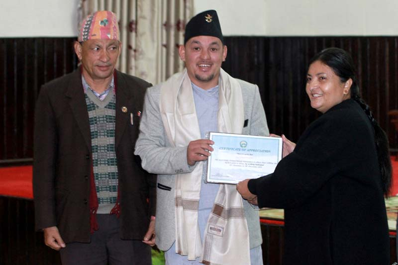 President Bidya Devi Bhandari felicitating ultra runner and mountaineer Sanjay Pandit at a programme organised at the office of the President at Sheetal Niwas on Tuesday, January 05, 2016. Photo: RSS