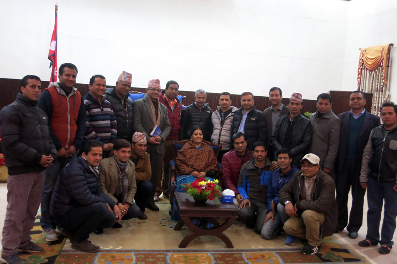 Journalists pose for a photograph with President Bidya Devi Bhandari  during a meeting at the Sheetal Niwas in Kathmandu on Thursday, January 28, 2016. Photo: RSS