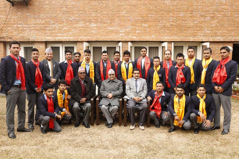 Prime Minister KP Sharma Oli posing with members of the U-19 National Cricket Team, before they leave for Bangladesh tomorrow to participate in the U-19 Cricket World Cup to be held next week, at his official residence at Baluwatar, on Tuesday, January 19, 2016. Photo: RSS